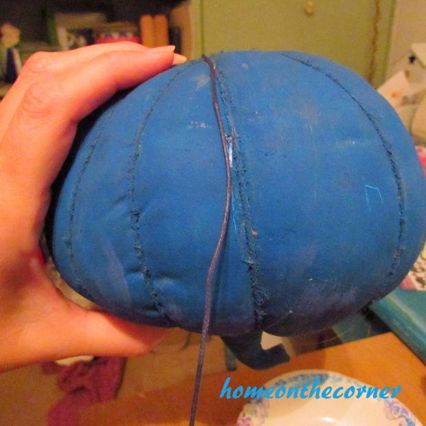 Small fabric pumpkin makeover gluing