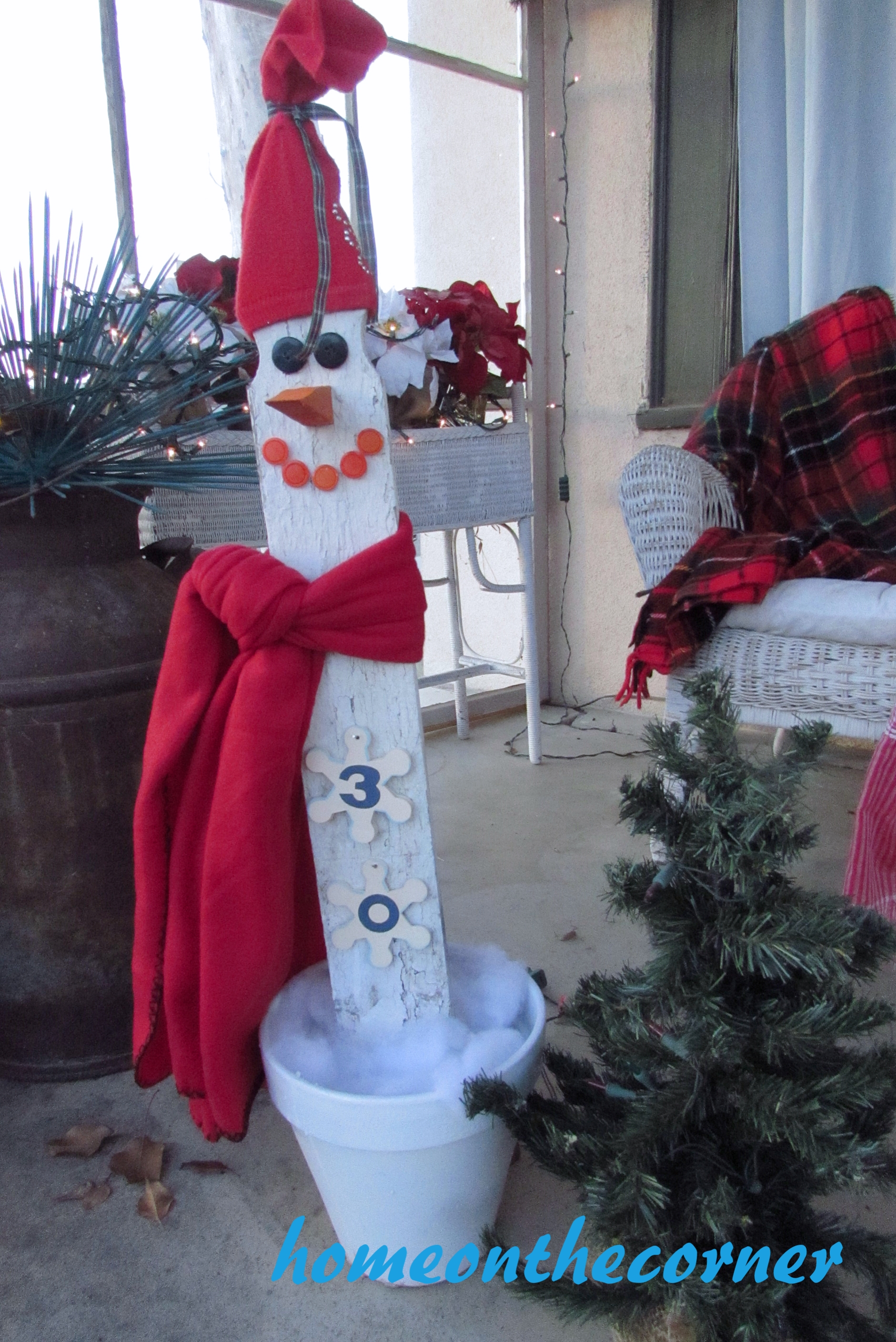picket snowman countdown on the porch
