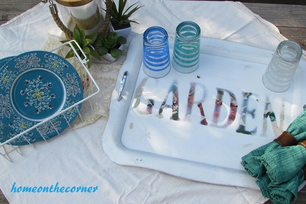 floral metal tray with glassware