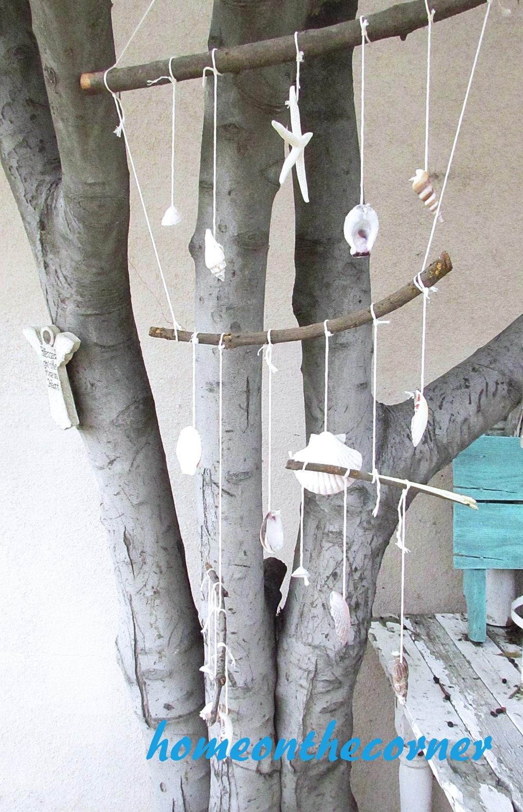 boho seashell mobile hanging outside