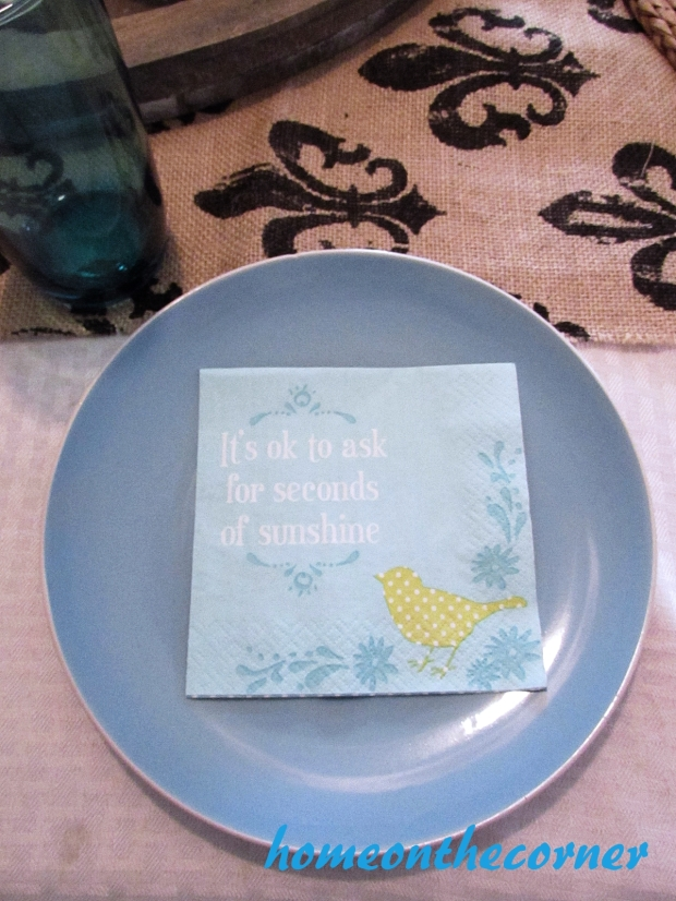 truquoise and white spring tablescape plate and napkin