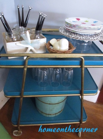 turquoise and white spring tablescape bar cart