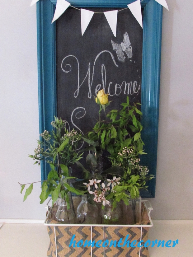 dining room refresh welcome flowers in bottles
