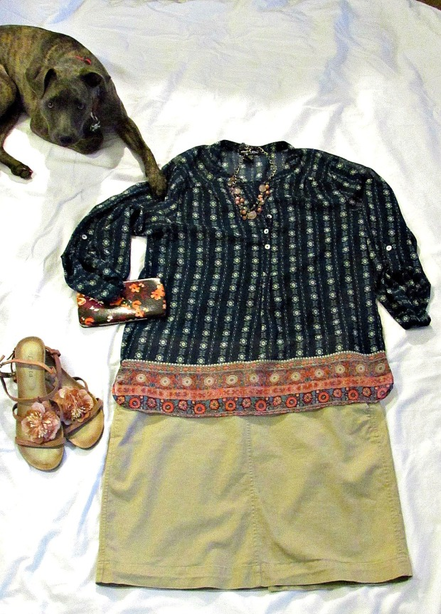 Turquoise fashions sheer top, khaki skirt