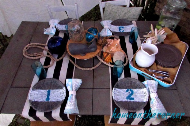 rattan chargers on a Nautical table