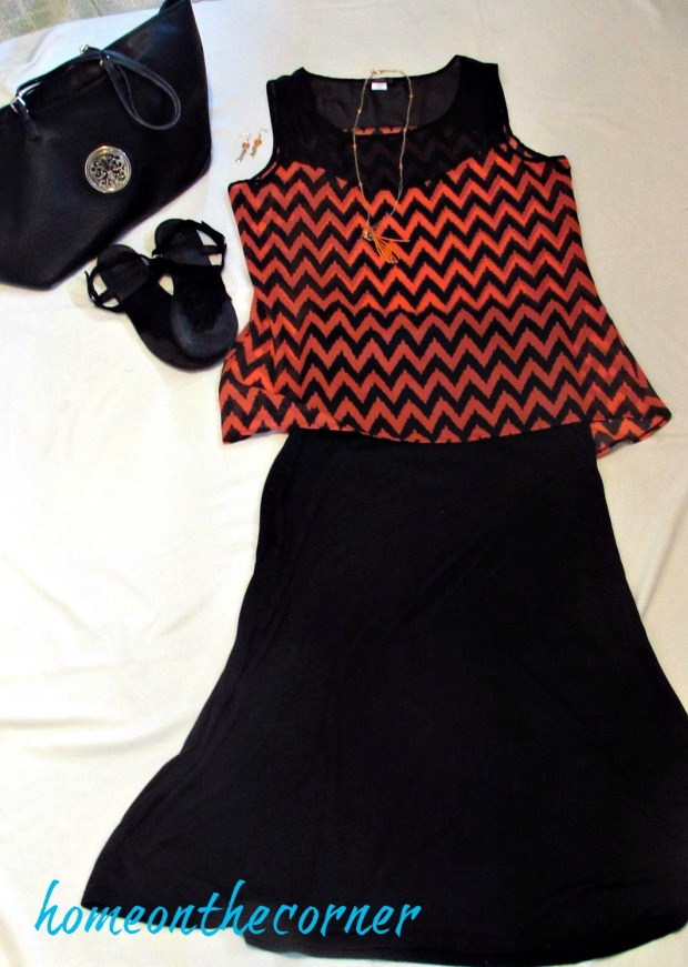 finds and fashions orange chevron shirt black skirt