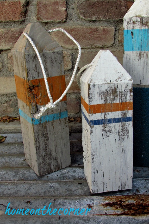 ocean wooden buoys orange, turquoise, blue