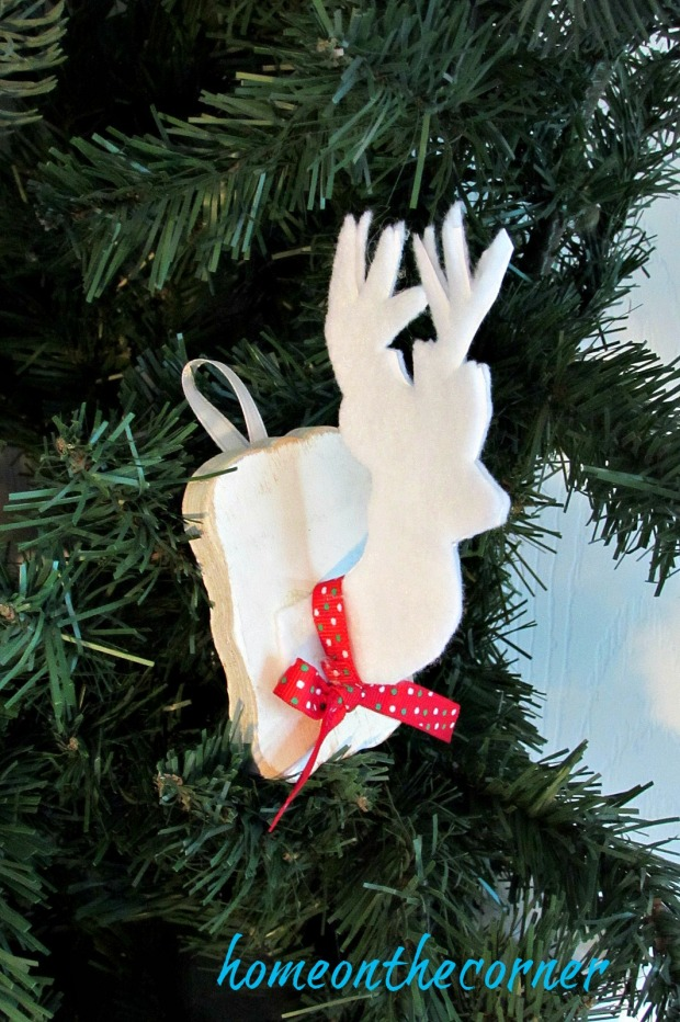 faux-deer-ornament-with-red-ribbon