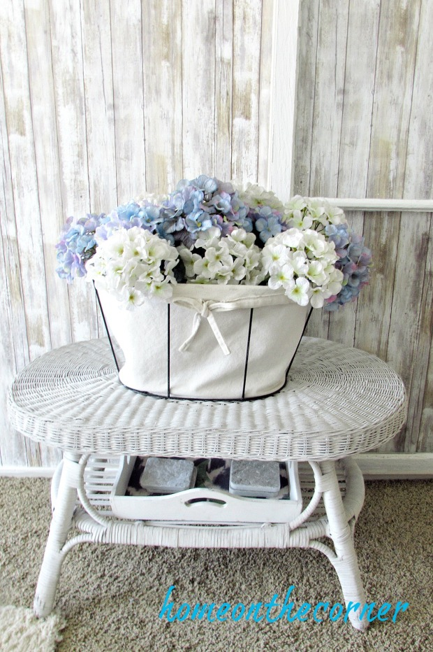 barn wood wallpaper hydrangeas and wicker table