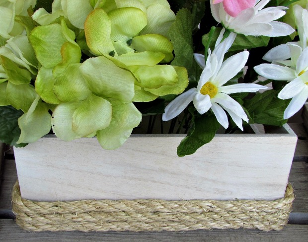 wooden box with flowers and rope