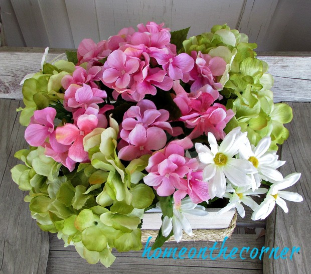 wooden flower box with hydrangeas and daisies