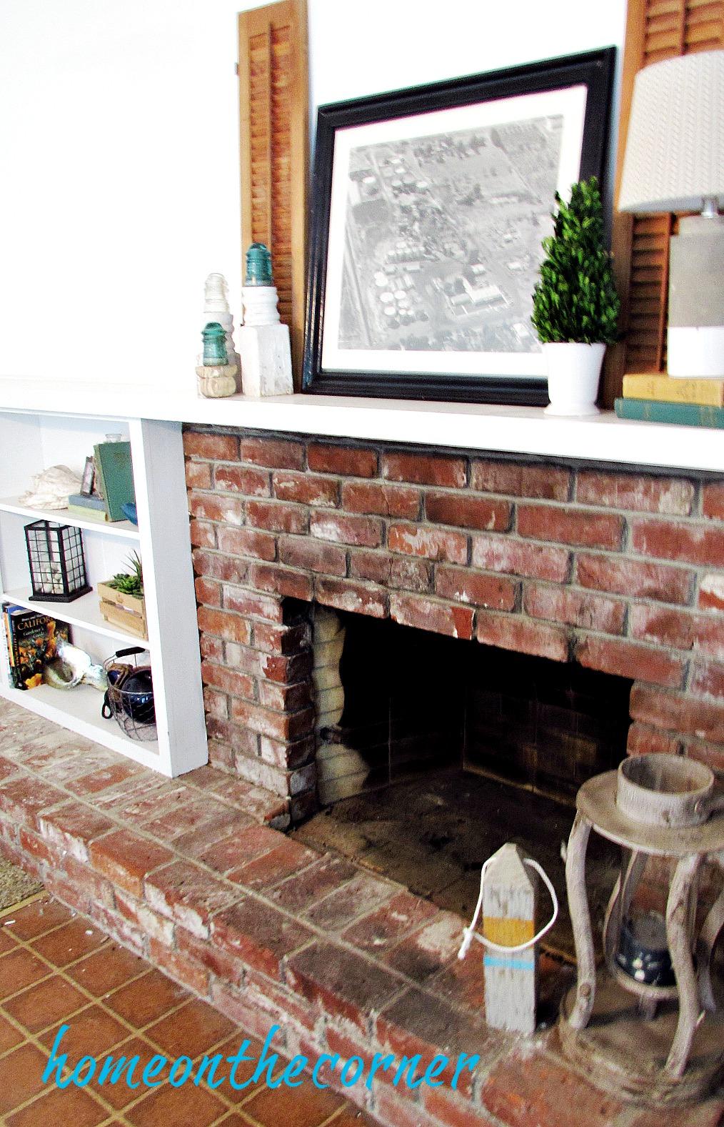family room fireplace mantel bookshelves