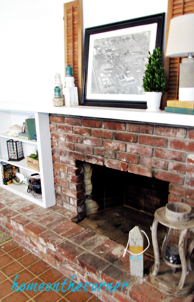 family room fireplace mantel bookshelves