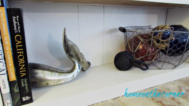 family room shelves coastal, whale tail, glass floats