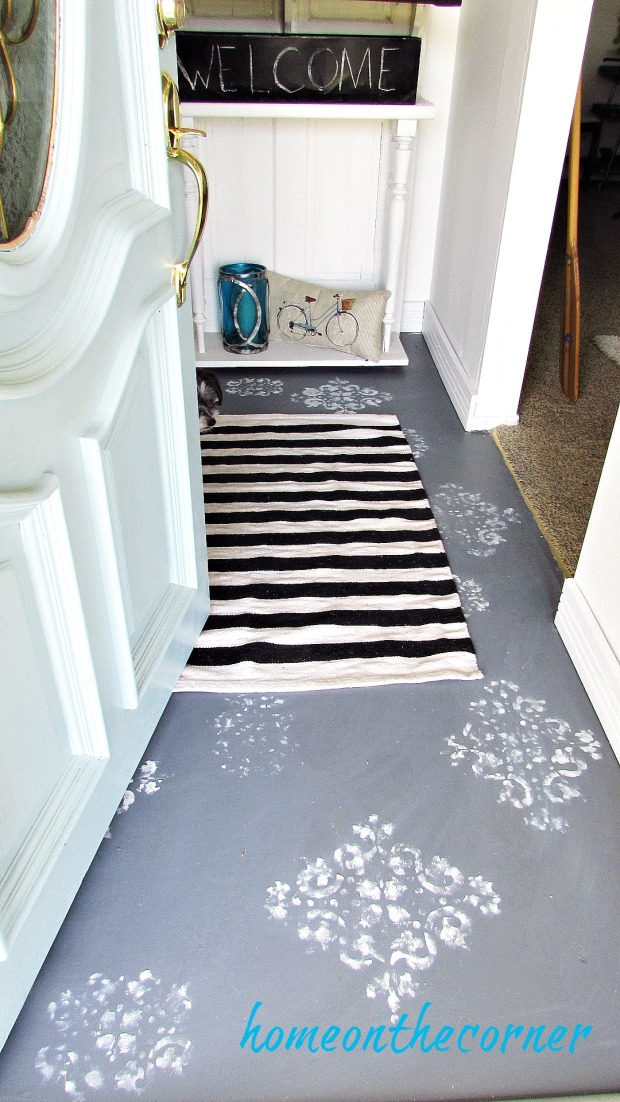 painted entryway floor with striped rug