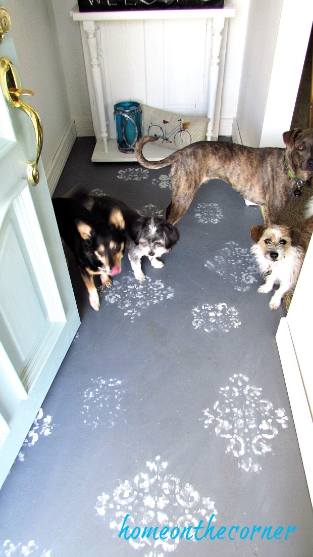 painted stencil entryway with dogs