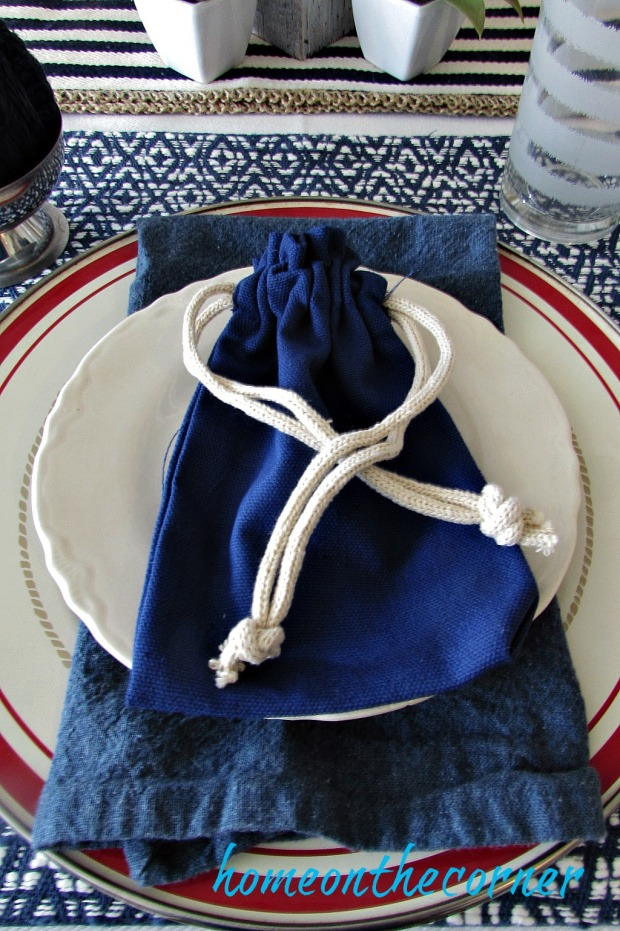 tablescapes 2017 blue and white with red and blue bags