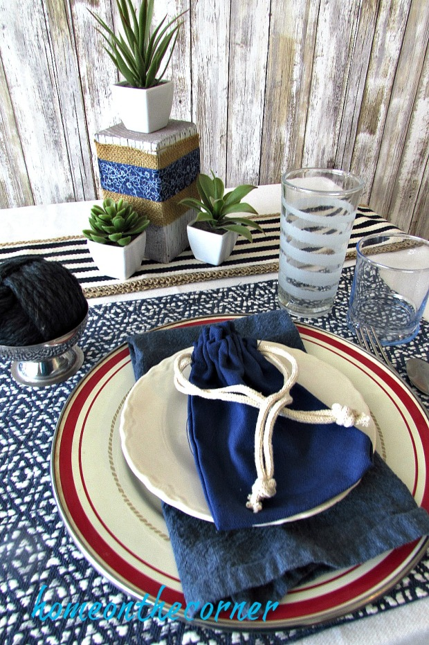tablescapes 2017 navy and white with succulents and blue bag