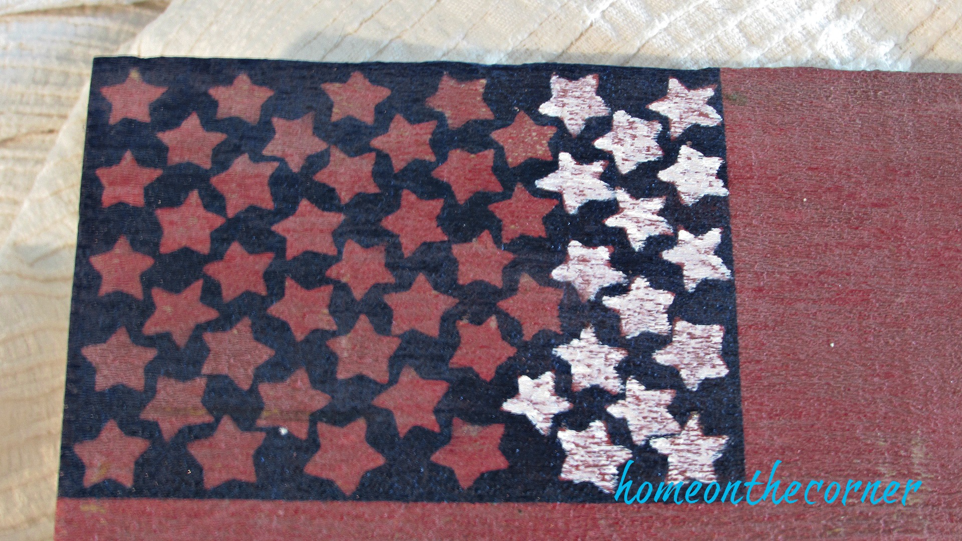 wooden flag with white stars