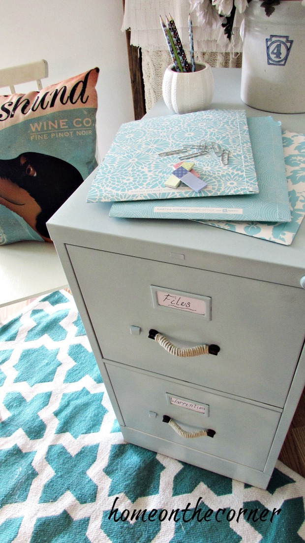 file cabinet makeover pencils, rug, crock