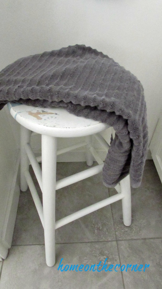 master bathroom makeover stool and grey towel