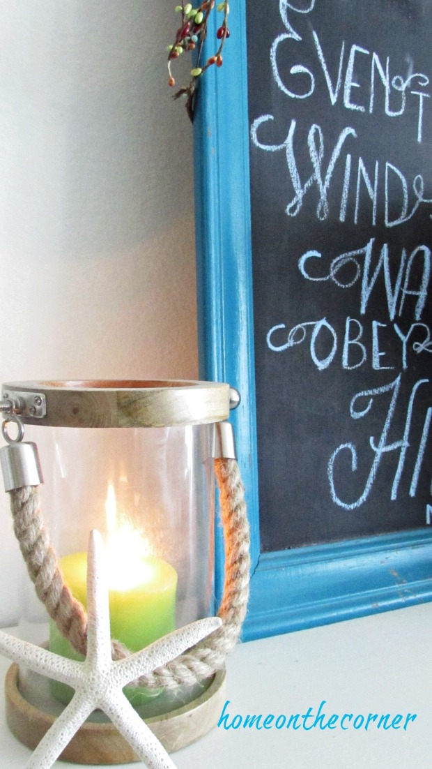 fall 2017 living room mantle candle and chalkboard