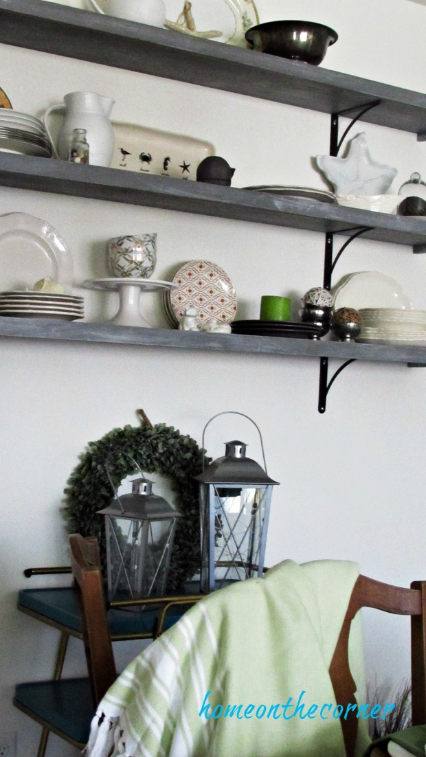 fall dining room green, black and white dishes, lanterns