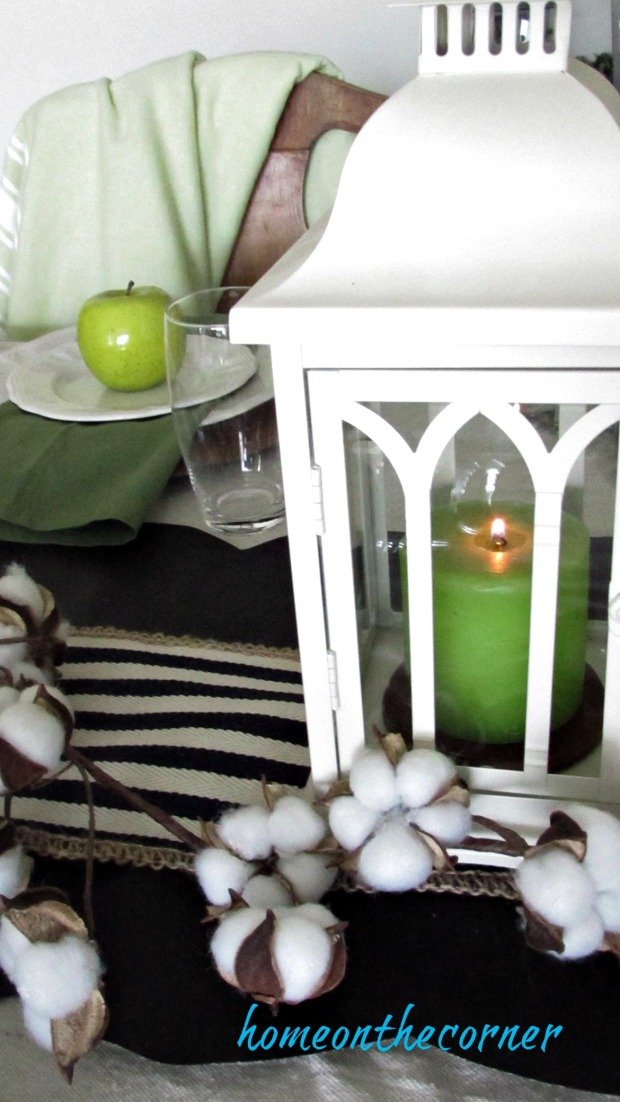 fall dining room green candle lantern, apples