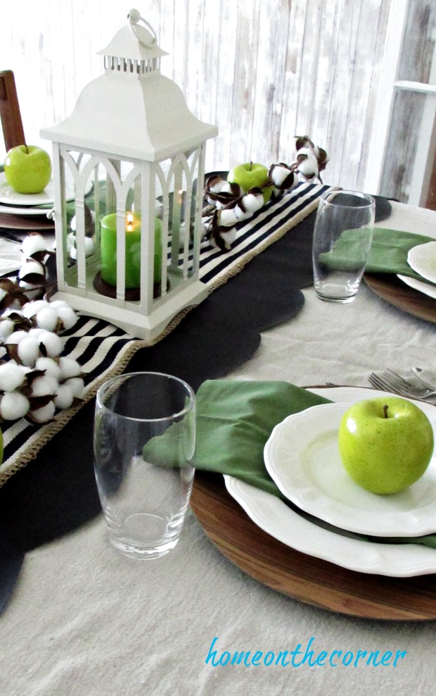 green and black dining room with apples