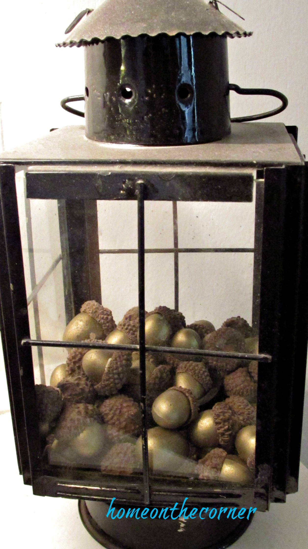 fall family room lantern with acorns