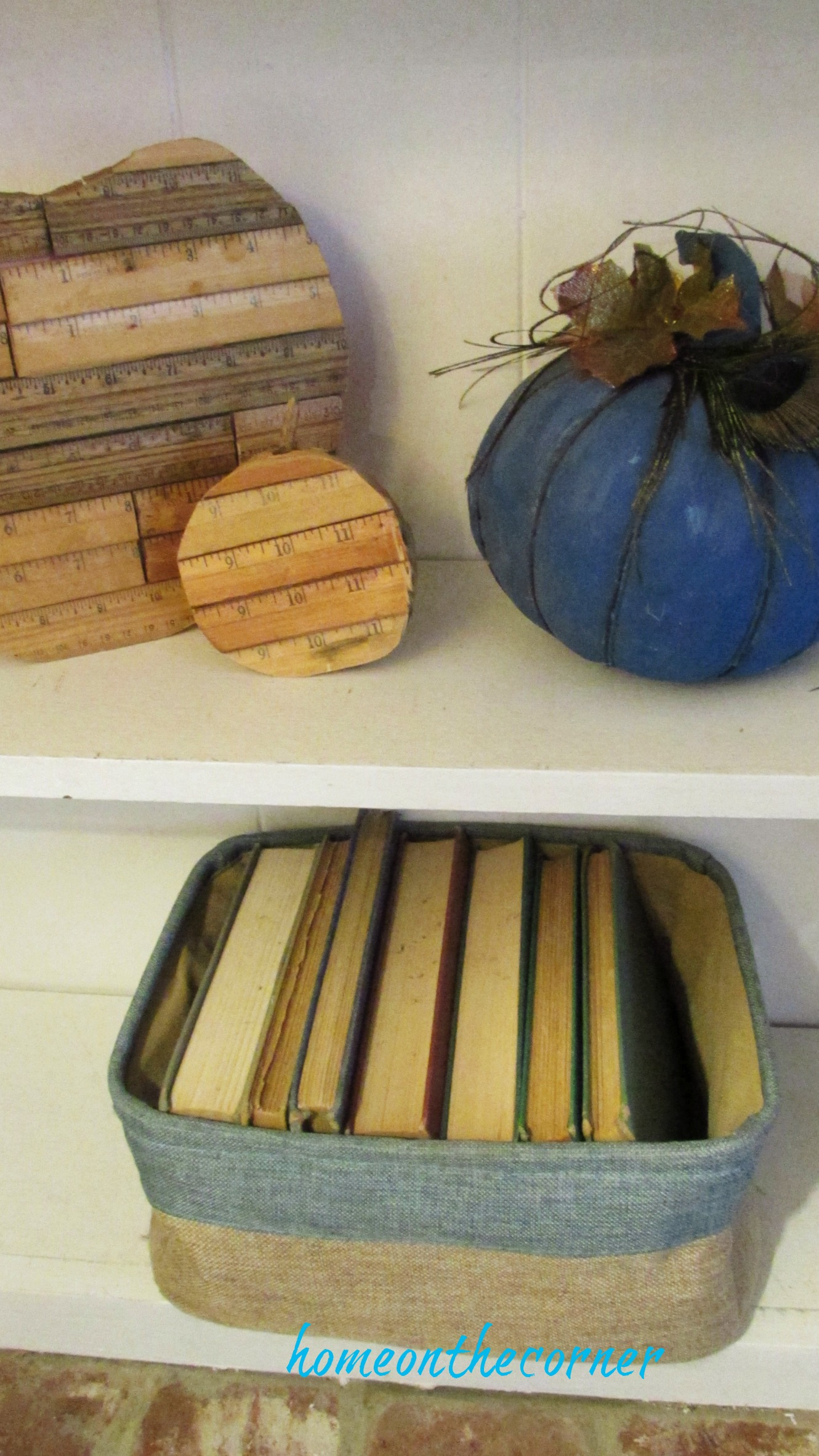 fall family room ruler pumpkins and books