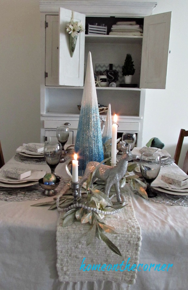 christmas 2017 dining room turquoise and white tablescape and hutch