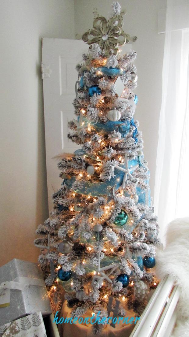 christmas 2017 white flocked beach tree turquoise and white