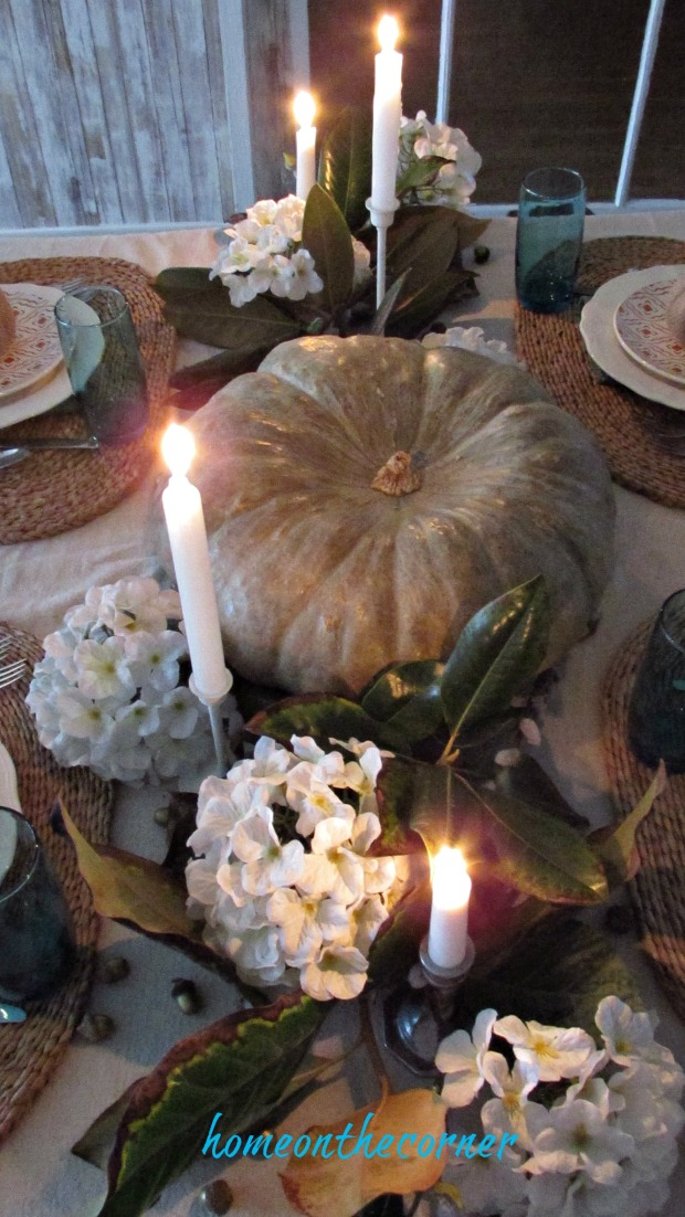fall tablescape 2017 pumpkin, candles, hydrangeas, magnolia leaves