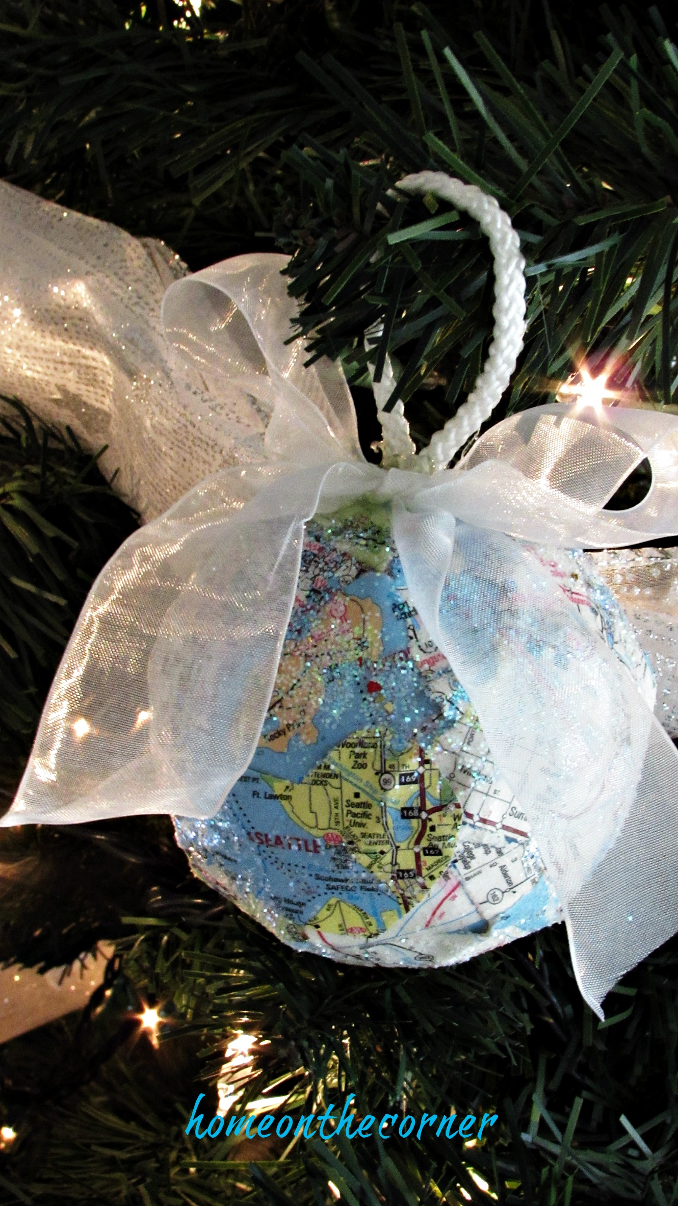 travel ornament blue green glitter map pieces