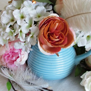 party tablescape blue pitcher with flowers