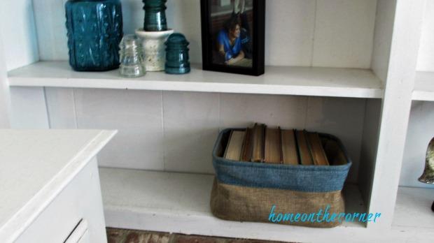 family room bookshelves basket of books