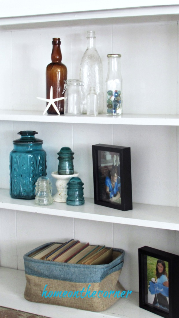 family room bookshelves bottles