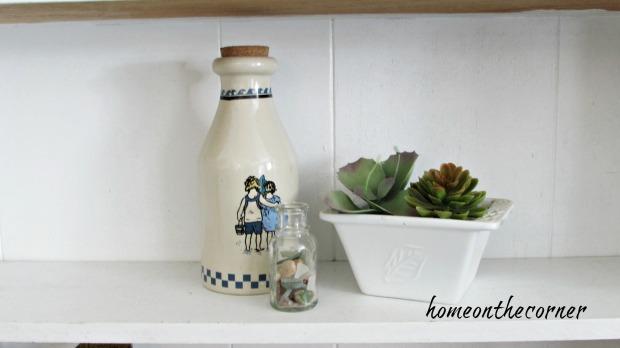 family room bookshelves seashore bottle