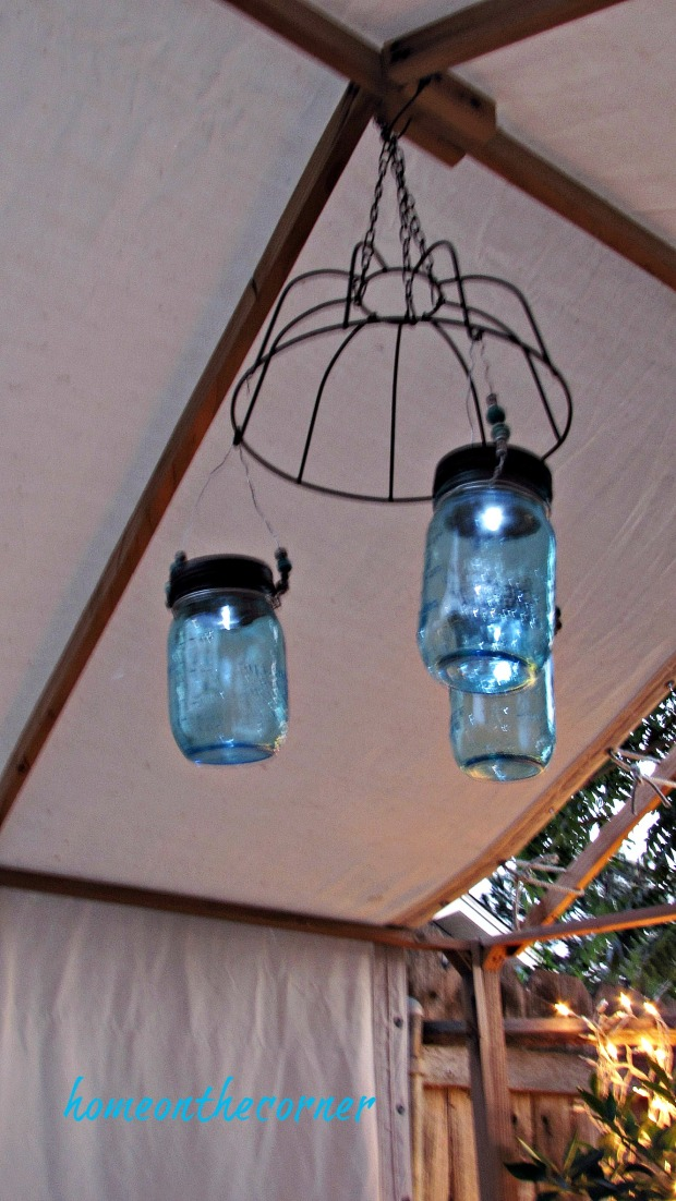 backyard gazebo nighttime mason jar lights