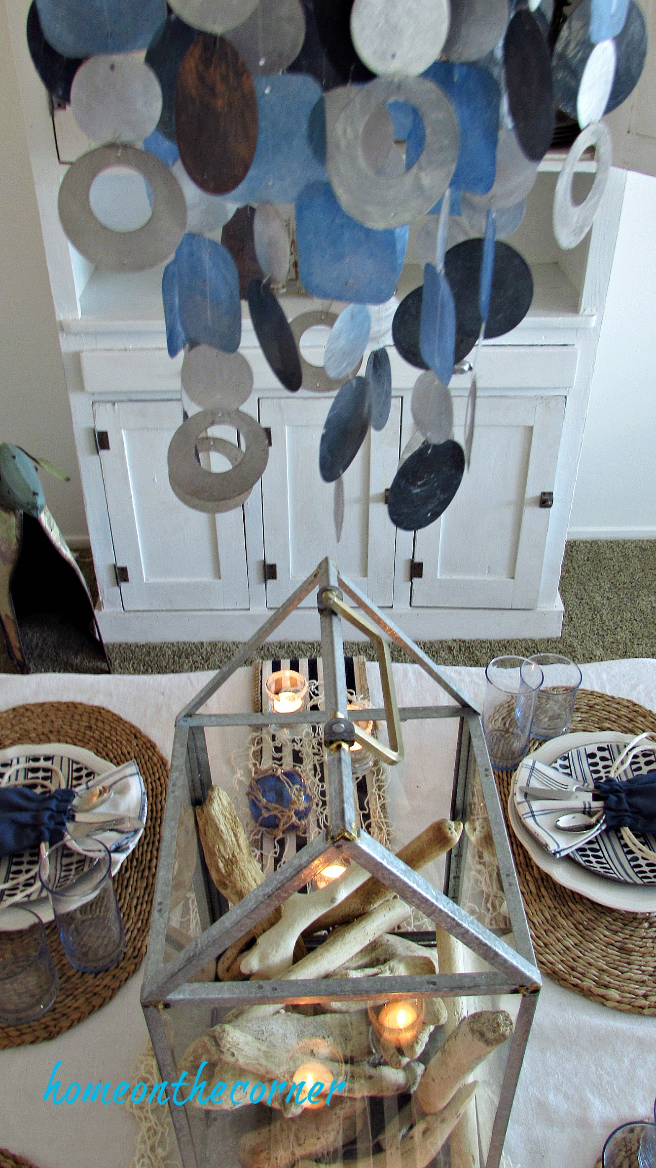 blue and white dining room capiz shell lamp and centerpiece