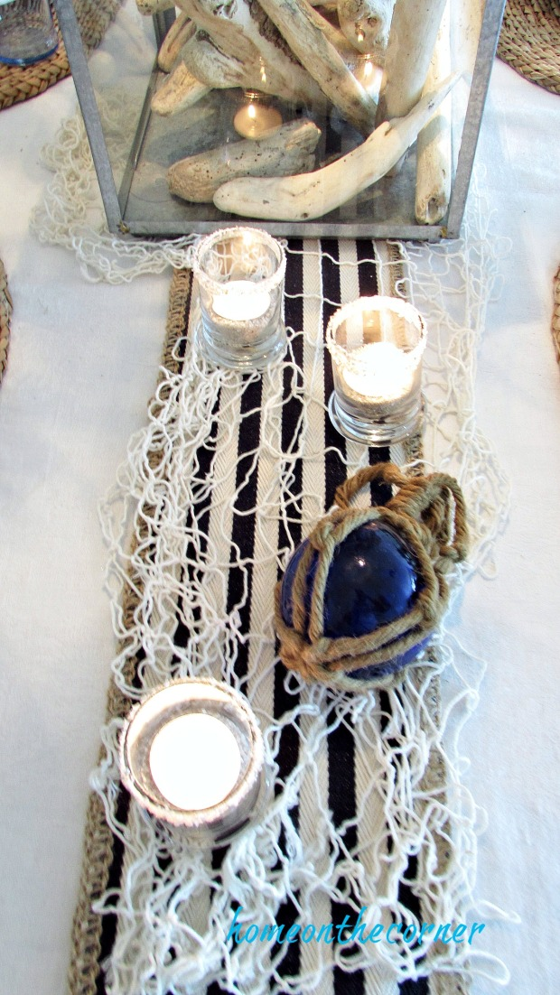 blue and white dining room fisherman net and candles