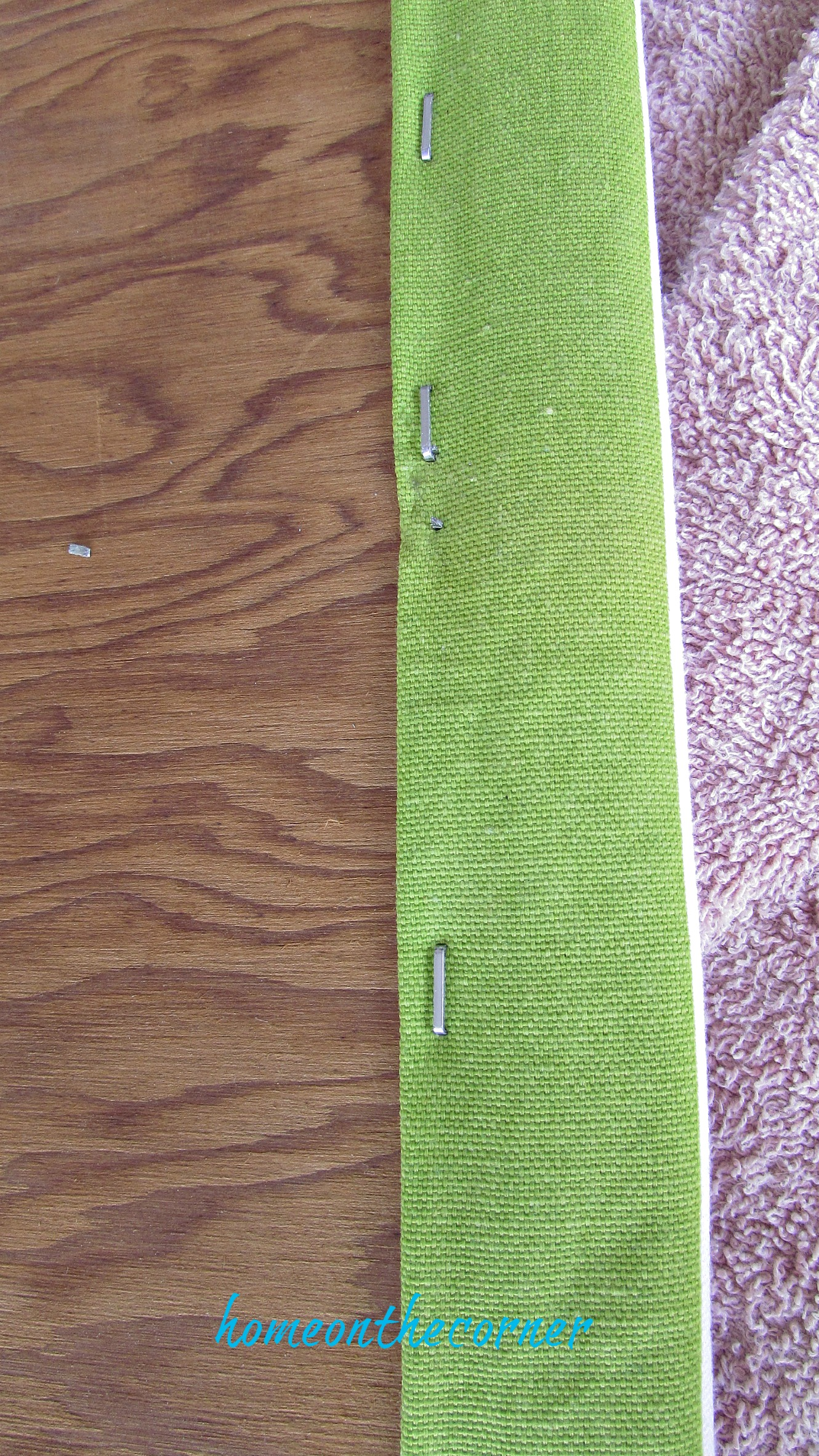 green and white bench makeover staple gun