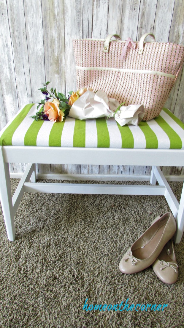 green and white striped bench makeover with flowers