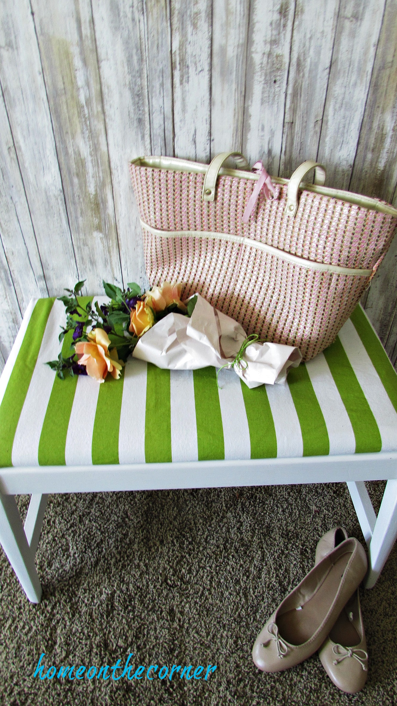 green and white striped bench pink purse