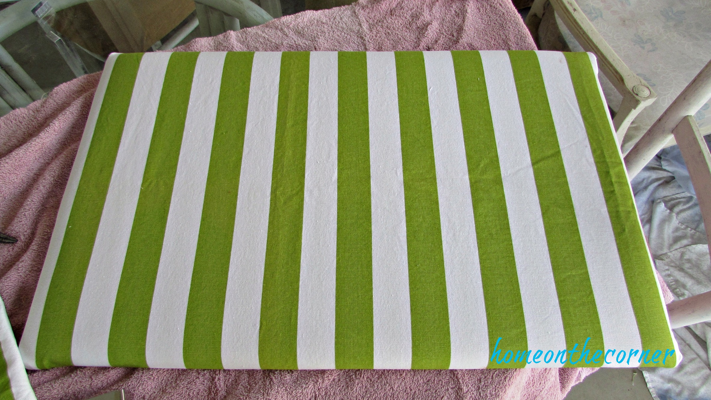 green and white striped bench top with fabric