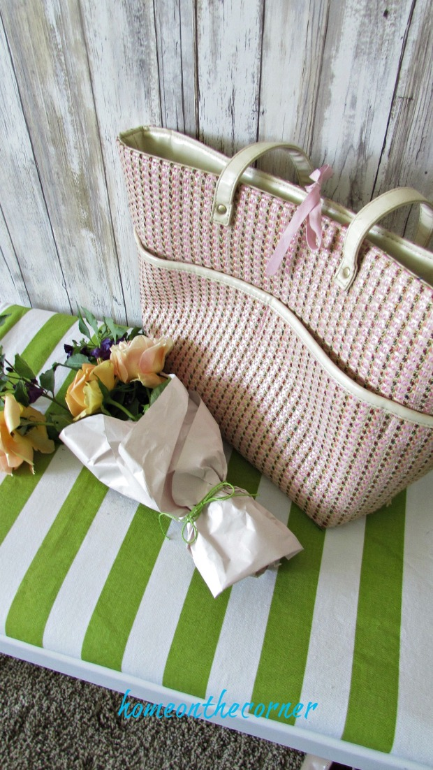 green and white striped bench with paper wrapped flowers