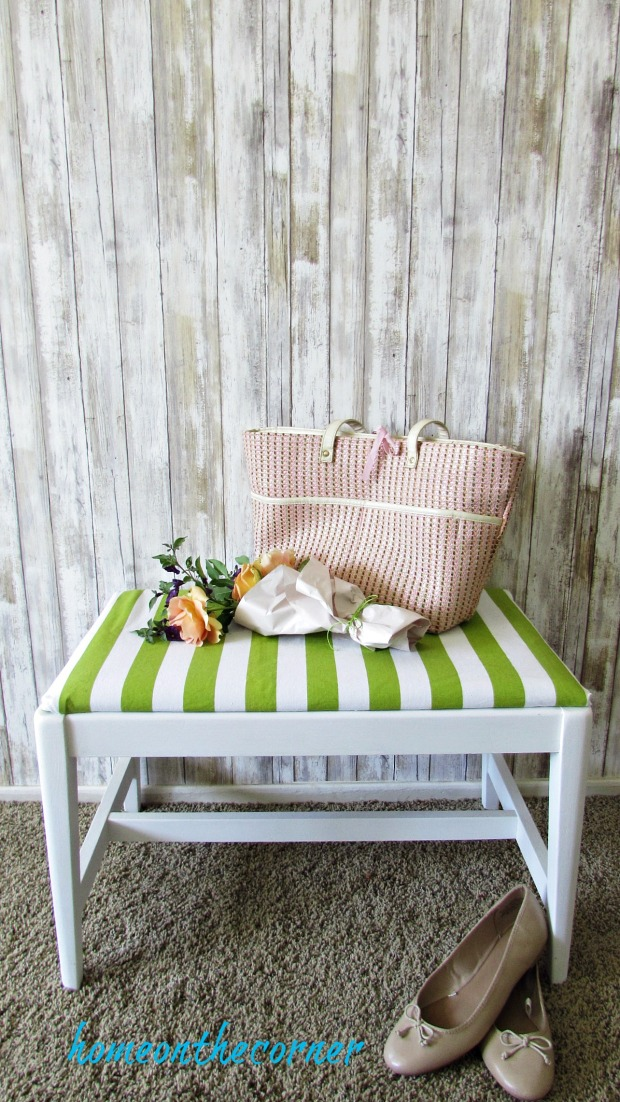 green and white striped fabric bench with shoes