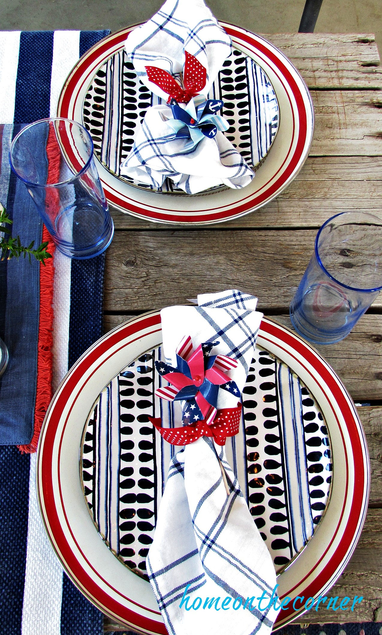 Red, white and blue outdoor table red plates