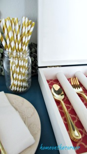 wooden box gold flatware coral fabric